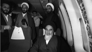 Ayatollah Khomeini on board an aeroplane with others