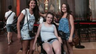 Three girls in the Sagrada Familia cathedral in Barcelona