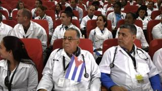 Some 100 Cuban doctors follow proceedings during their induction programme at the Kenya School of Government, on June 11, 2018 in Nairobi. - The doctors will be posted to various hospitals in Kenya's 47 counties. Each county is expected to get at least two doctors