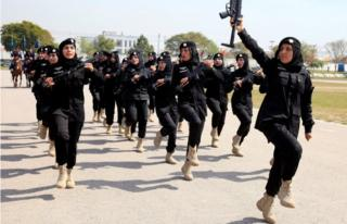 Female members of police commandos march during at their headquarters in Islamabad, Pakistan