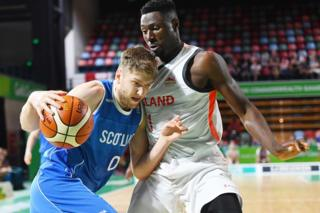 Michael Vigor of Scotland competes against Daniel Edozie of England in basketball