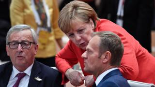 EU leaders Jean-Claude Juncker (L), Donald Tusk (R) and Germany's Chancellor Angela Merkel (C), 7 Jul 17