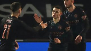 Phil Foden (centre)