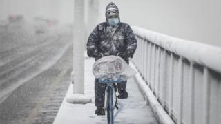 A man riding a bike in Wuhan - the epicentre of the coronavirus outbreak in China, 15 February 2020