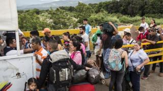Migrants cross the border in Cucuta, Colombia