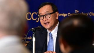 Cambodia's main opposition Cambodia National Rescue Party president Sam Rainsy speaks to the press in Tokyo on November 10, 2015.