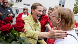 Mette Frederiksen, leader of The Danish Social Democrats gives roses to voters in a last minute campaign in Aalborg, Denmark.