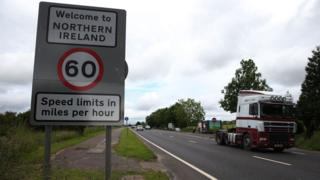 A sign at the Irish border that reads: 'Welcome to Northern Ireland - Speed limits in miles per hour'
