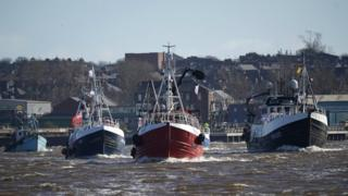 The flotilla of fishing boats on the River Tyne