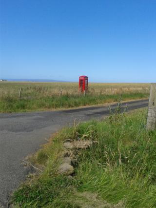 Phone box in a field