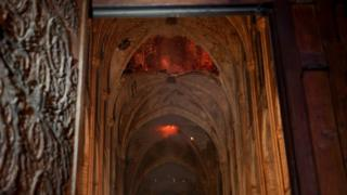 Flames and smoke rise from the interior of Notre-Dame Cathedral in Paris on April 15, 2019