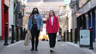 Young women wearing masks in Northern Ireland