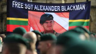 Protesters holding a Free Sgt Alexander Blackman banner