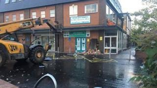 Telescopic handler at shop in Culcheth