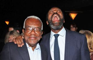 Sir Tevor McDonald meets actor Lenny Henry following his performance on press night of 'Fences' at the Duchess Theatre in London