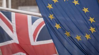 EU and UK flags fly above the EU Commission offices in Westminster