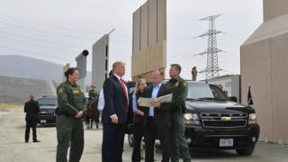 US President Donald Trump inspects border wall prototypes in San Diego, California.