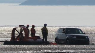 Car stranded on mudflats