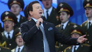 Singer Iosif Kobzon and a Russian military choir perform in a concert near Red Square on 18 March 2016