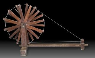A wooden charkha or spinning wheel