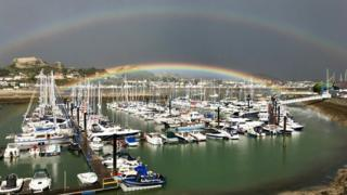 A double rainbow shines over Conwy marina, which was captured by Frank Maher