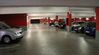 A picture taken on 25 July 2018 in the northern Paris suburb of Sarcelles shows the car park where the car abandoned by French robber Redoine Faid was found