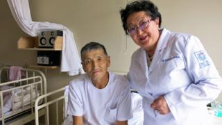 Davaasuren with Renchin, a patient at Mongolia's National Cancer Hospital