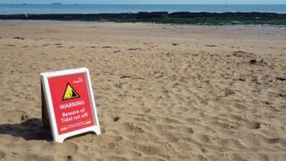 Tidal warning on Kent beach