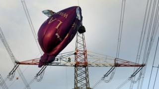 A hot air balloon stranded on an electricity pylon in Bottrop, western Germany