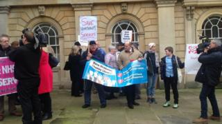 Protestors outside the county council