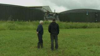 Raymond Pollock and his son are taking legal action against the firm that built an anaerobic digester on their farm