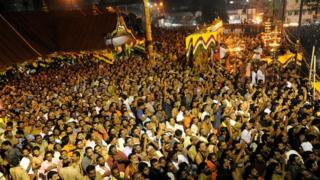 Hindu devotees pray at the Sabarimala temple during the Maravilakku festival marking the final of a two-month pilgrimage to the Lord Ayyappa temple in Kerala, south India on January 14, 2011.
