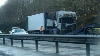 Burnt-out lorry being removed