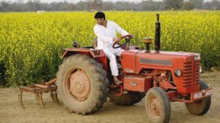 An Indian farmer on a tractor