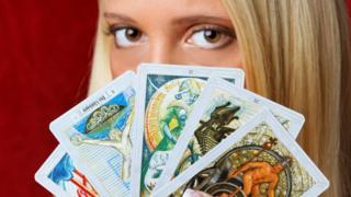 Woman with tarot cards