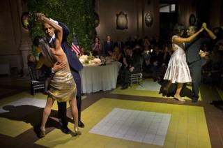 US President Barack Obama and first lady Michelle Obama, right, dance the tango with tango dancers during the State Dinner at the Centro Cultural Kirchner in Buenos Aires, Argentina, on 23 March 2016.