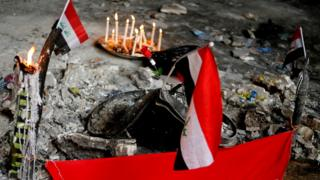 Candles are seen at the site of a suicide car bomb attack over the weekend at the shopping area of Karrada in Baghdad, July 6, 2016