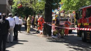 Emergency workers outside India and France's consulates in Melbourne