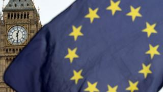 European Union flag flies in front of UK Parliament