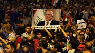 Demonstrators chant in support of Iraqi Prime Minister Haider al-Abadi, during a demonstration at Tahrir Square in Baghdad, on 9 August 2015