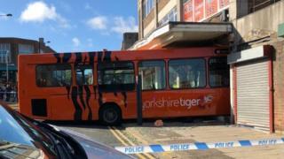 A tiger bus crashes into a shop in Shipley