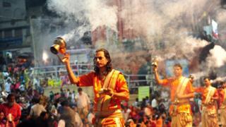 Indian Hindu priests perform Ganga Arti Puja at Dashasamedh Ghat on the River Ganges in Varanasi