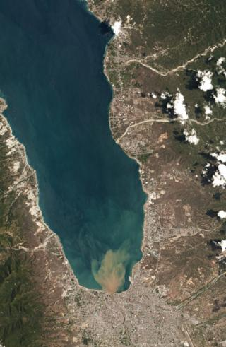 Satellite image showing the long thing bay leading to Palu