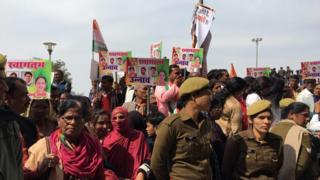 Supporters greet Priyanka Gandhi in Lucknow