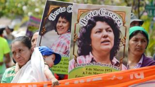 Berta Caceres posters are carried during a International Women's day demonstration in Tegucigalpa on March 08, 2016