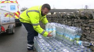 Bottled water being handed out in Shap