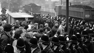 Police surround a group of striking miners during the 1984-85 Miners' Strike