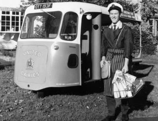 A milkman with his electric milk delivery float, 1972
