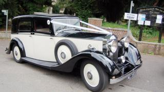 Rolls Royce vintage car with wedding ribbons