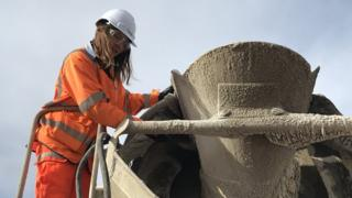 Manager and ex-apprentice Emily Burridge inspects a batch of concrete